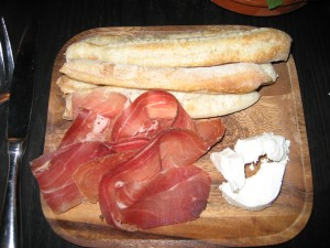 Breadsticks with prosciutto and goat cheese.