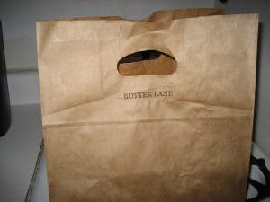 The cupcakes come in this cute brown bag.